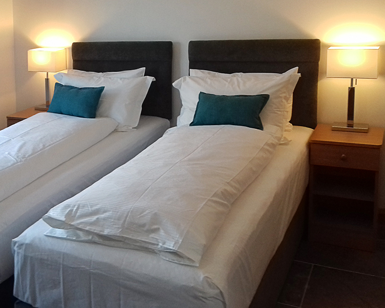 Room One - All bedroom accommodation is spacious, en-suite shower-room and tastefully decorated to a high standard.